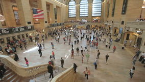 Timelapse of people in Grand Central Station in Manhattan, New York. Timelapse of travelers hurrying through Grand Central Station in Manhattan, New York City stock footage