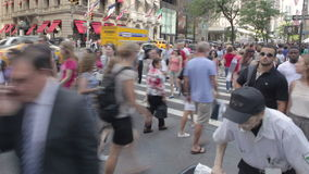 Timelapse people in New York City. Timelapse panning shot of pedestrian crowds flooding an intersection along Manhattan's 5th Ave., one of the busiest streets in stock footage