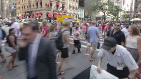 Timelapse people in New York City. Timelapse shot of pedestrian crowds flooding an intersection along Manhattan's 5th Ave., one of the busiest streets in the stock video footage