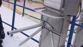 Timelapse of People Passing through the Turnstile with Barcode Reading Feature to Rise Up on Ski Resort. Timelapse of People Passing through the Turnstile with stock video footage