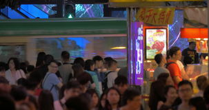 Timelapse of people traffic in Hong Kong street. HONG KONG - NOVEMBER 09, 2015: Timelapse shot of people traffic on busy city street in the evening. Crowd stock footage