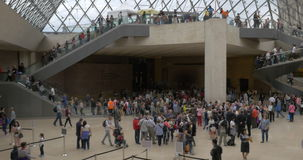 Timelapse of people traffic in the Louvre Pyramid entrance hall stock footage
