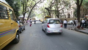 Timelapse of people and traffic on the street of Mumbai. stock video