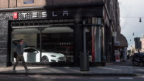 Timelapse of people and traffic in street with Tesla Store. AMSTERDAM, NETHERLANDS - AUGUST 09, 2016: Timelapse shot of transport and people traffic on the stock video