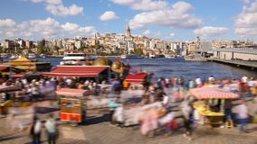 Timelapse of people walking around famoust tourist place in Istanbul with Galata Tower view and Bosphorus. Timelapse of people walking around famoust tourist stock footage