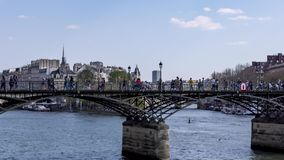 Timelapse: People walking on Pont des Arts bridge on the Seine river - Paris
