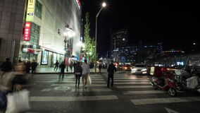 Timelapse of people on zebra crossing at night. Seoul, South Korea stock video footage