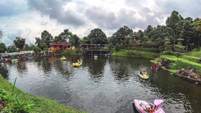 Timelapse of peoples driving water bike, pedalo, paddle boat in large waterpool stock video