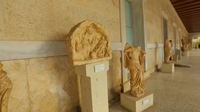 Timelapse of person viewing exhibits, statues at ancient Agora museum in Athens. Stock footage stock video