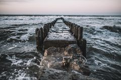 Timelapse Photography of Body of Water and Waves on Dike Stock Photo