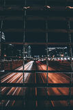 Timelapse Photography of Road at Night from Behind a Bar Royalty Free Stock Photos