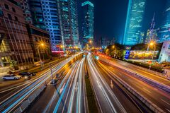Timelapse Photography of Vehicle on Concrete Road Near in High Rise Building during Nighttime Stock Photography