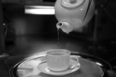 Timelapse Photography of Water Pouring from White Ceramic Teapot to White Ceramic Mug on White Saucer Royalty Free Stock Image