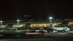 Timelapse of planes and vehicles in Vnukovo Airport at night, Moscow stock video footage