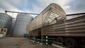 Timelapse of probe tester plunges into the truck trailer to collect wheat for quality analysis. Automatic control system