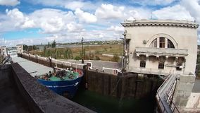 Timelapse : Process of sluicing river barges for transportation of cargo in airlock sluice of Volgo-don shipping canal stock footage