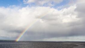 Timelapse of rainbow in lake sky stock video footage