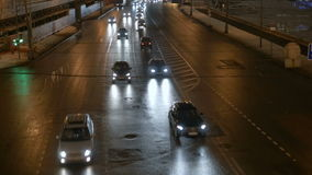 Timelapse. Rapid movement of cars on city streets. In evening time. Big wide road stock footage
