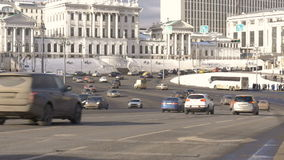 Timelapse. Rapid movement of cars on city streets. On a sunny day. Big wide road stock video footage