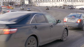 Timelapse. Rapid movement of cars on city streets. On a sunny day. Big wide road stock video