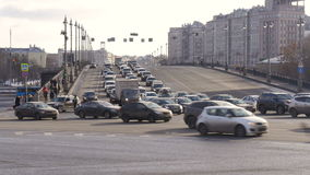 Timelapse. Rapid movement of cars on city streets. On a sunny day. Big wide road stock footage