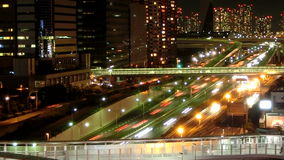 Timelapse of rapid night transportation in Tokyo. Timelapse of rapid transportation and illumination in downtown Tokyo stock video footage