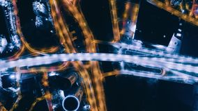 Night Riga drone timelapse city bridge viaduct road traffic machine Drone fast time cars in motion. Timelapse Riga city drone flight above bridge with cars stock video footage