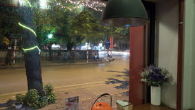 Timelapse of road traffic and cafe interior in Hanoi, Vietnam. HANOI, VIETNAM - OCTOBER 27, 2015: 360 degrees rotating timelapse shot of roadside cafe interior stock footage