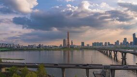 Timelapse. rolling clouds sky at  Seoul city South Korea. in Han River and 63 building
