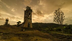 Timelapse ruin historical church in the evening with golden cloud
