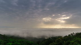 Timelapse scene of moving cloud over tropical forest hill stock footage