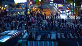 A timelapse of the scramble crossing at the neon town in Shibuya Tokyo tilt shift panning. A timelapse of the scramble crossing at the neon town tilt shift stock video footage
