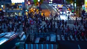 A timelapse of the scramble crossing at the neon town in Shibuya Tokyo tilt shift panning. A timelapse of the scramble crossing at the neon town tilt shift stock footage