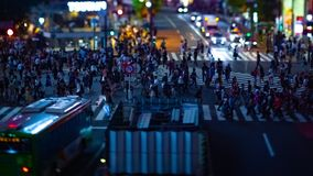 A timelapse of the scramble crossing at the neon town in Shibuya Tokyo tilt shift. A timelapse of the scramble crossing at the neon town tilt shift. Shibuya stock video footage