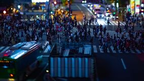 A timelapse of the scramble crossing at the neon town in Shibuya Tokyo tilt shift. A timelapse of the scramble crossing at the neon town tilt shift. Shibuya stock footage