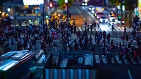 A timelapse of the scramble crossing at the neon town in Shibuya Tokyo tilt shift zoom. A timelapse of the scramble crossing at the neon town tilt shift zoom stock video