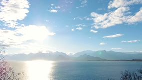 Timelapse. Sea view at sun rays on the mountains background. stock video footage