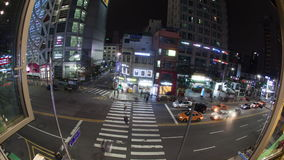Timelapse of Seoul traffic at night, South Korea. SEOUL, SOUTH KOREA - OCTOBER 22, 2015: Timelapse panning and wide angle shot of city highway with car traffic stock video footage