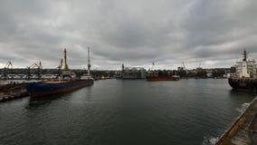 Timelapse of ship mooring at big grain silo terminal at seaport. Preparation of cereals bulk transshipment to vessel. Timelapse of ship mooring at big grain silo stock video