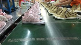 Timelapse of shoe making process on conveyor stock video