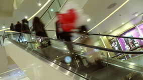 Timelapse Of Shoppers Riding An Escalator At A stock video footage