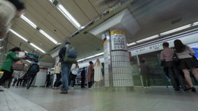 Timelapse shot of people on underground station in Seoul, South Korea. SEOUL, SOUTH KOREA - OCTOBER 22, 2015: Timelapse low angle shot of people traffic on stock video footage