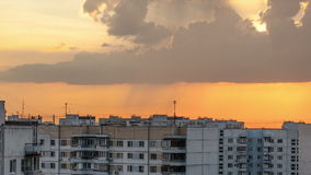 Timelapse of sky with clouds during sunset in city Stock Images