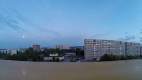 Timelapse of small european city taken from the roof. Flying clouds at night and day stock footage