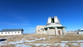 Timelapse of the solar observatory. Rotation of the opening and closing of the dome of the astronomical telescope of the. Coronograph in the daytime in winter stock footage