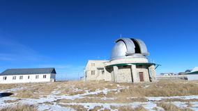 Timelapse of the solar observatory. Rotation of the opening and closing of the dome of the astronomical telescope of the. Coronograph in the daytime in winter stock video footage
