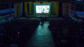 Timelapse of Stage in Children`s Camp, Spectators in Crowd Take Places in Hall