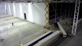 Timelapse stage of walling in large warehouse facility stock video