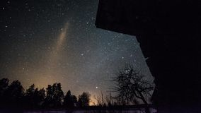 Timelapse of stars over timber house at winter night. stock video