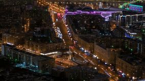 Timelapse static aerial view - fast moving cars traffic at night city street stock video footage